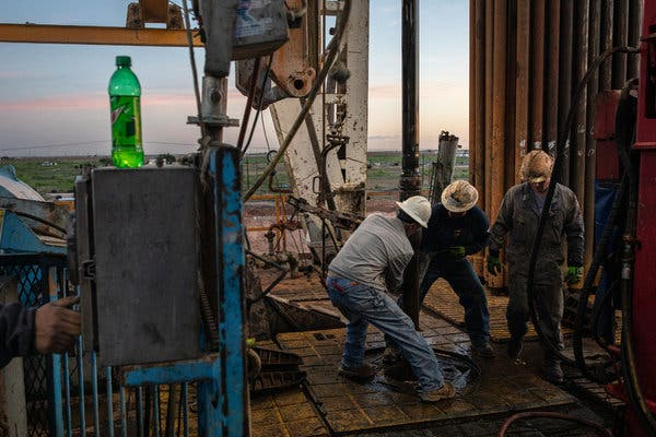 Workers at Latshaw Drilling's Rig 19 near Stanton, Texas, last week.